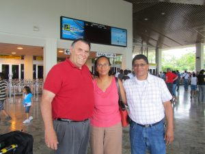 Bro. Doug being met at the airport by Bro. Manuel and Sis. Sylvia Fernandez